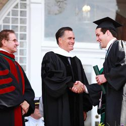 Mitt Romney and Southern Virginia University Chairman Glade Knight congratulate a member of the class of 2013 on April 27, 2013.