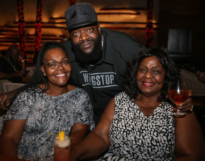 Rick Ross poses with his Mother and Sister
