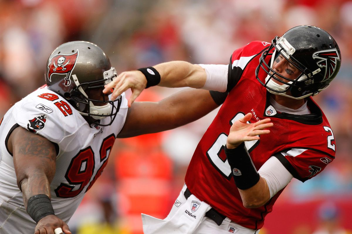 TAMPA, FL - SEPTEMBER 25:  Quarterback Matt Ryan #2 of the Atlanta Falcons is hit by Brian Price #92 of the Tampa Bay Buccaneers at Raymond James Stadium on September 25, 2011 in Tampa, Florida.  (Photo by Mike Ehrmann/Getty Images)