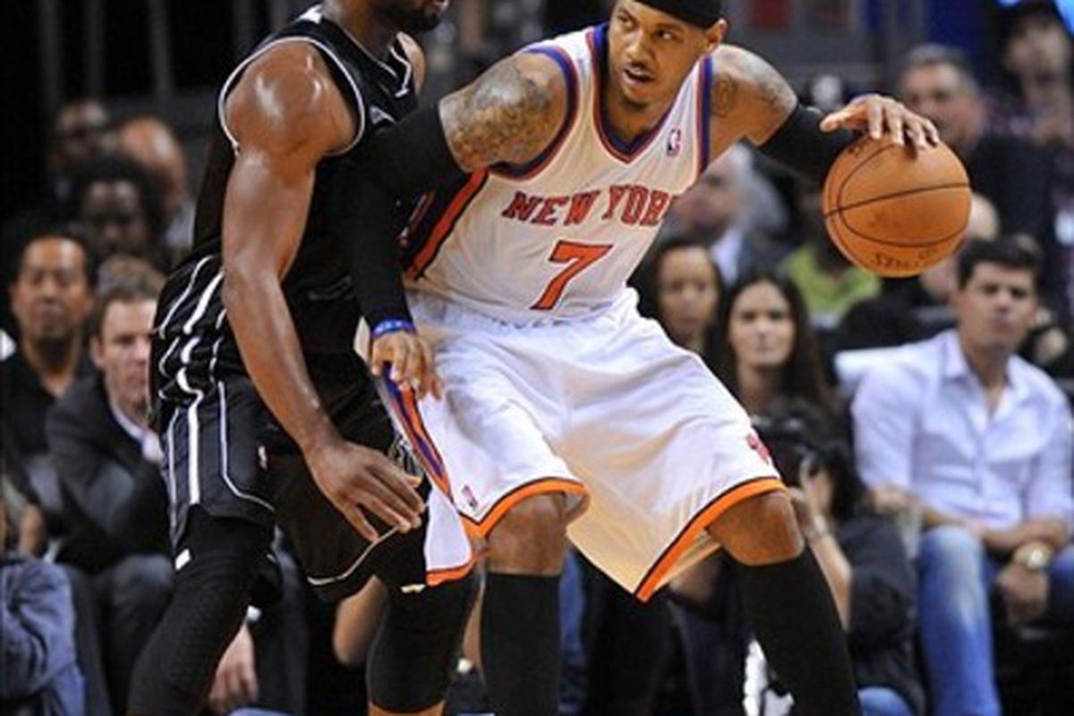 Feb. 23, 2012; Miami, FL, USA; New York Knicks small forward Carmelo Anthony (7) is pressured by Miami Heat shooting guard Dwyane Wade (3) during the second half at American Airlines Arena. Mandatory Credit: Steve Mitchell-US PRESSWIRE