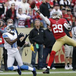 San Francisco 49ers defensive back Chris Culliver, right, breaks up a pass intend for Detroit Lions wide receiver Titus Young, left, during the first quarter of an NFL football game in San Francisco, Sunday, Sept. 16, 2012. A pass interference penalty was called on the play.