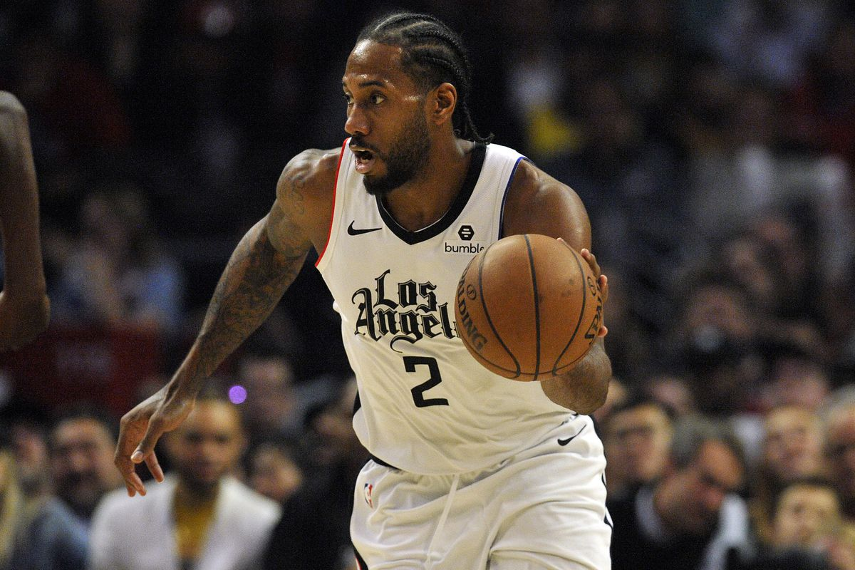 Los Angeles Clippers forward Kawhi Leonard moves the ball down court against the Houston Rockets during the second half at Staples Center.