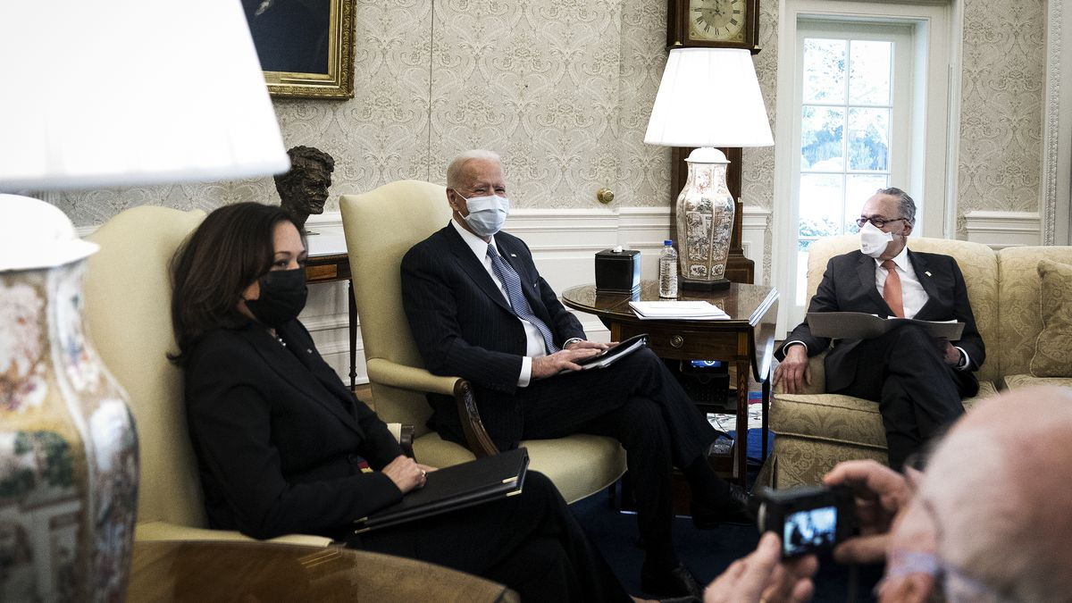 Vice President Kamala Harris, President Joe Biden, and Senate Majority Leader Chuck Schumer sitting in the Oval Office of the White House.