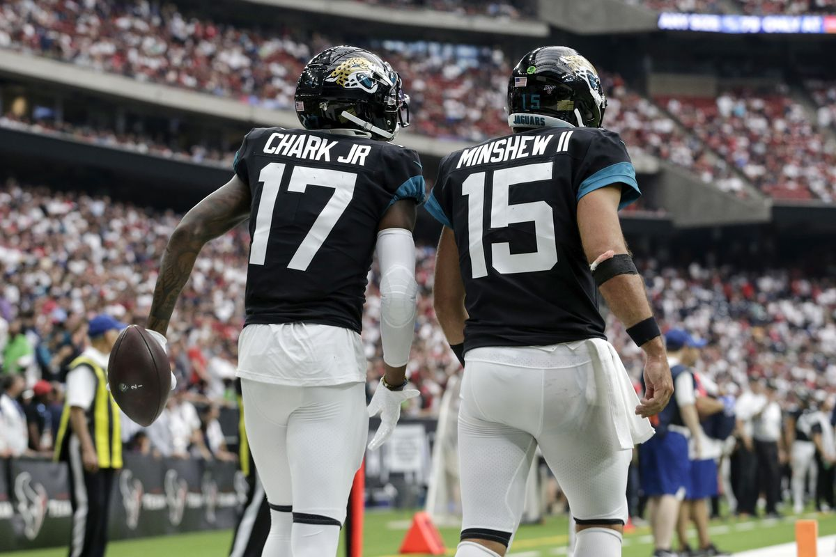 Gardner Minshew of the Jacksonville Jaguars congratulates D.J. Chark after a touchdown reception in the fourth quarter against the Houston Texans at NRG Stadium on September 15, 2019 in Houston, Texas.