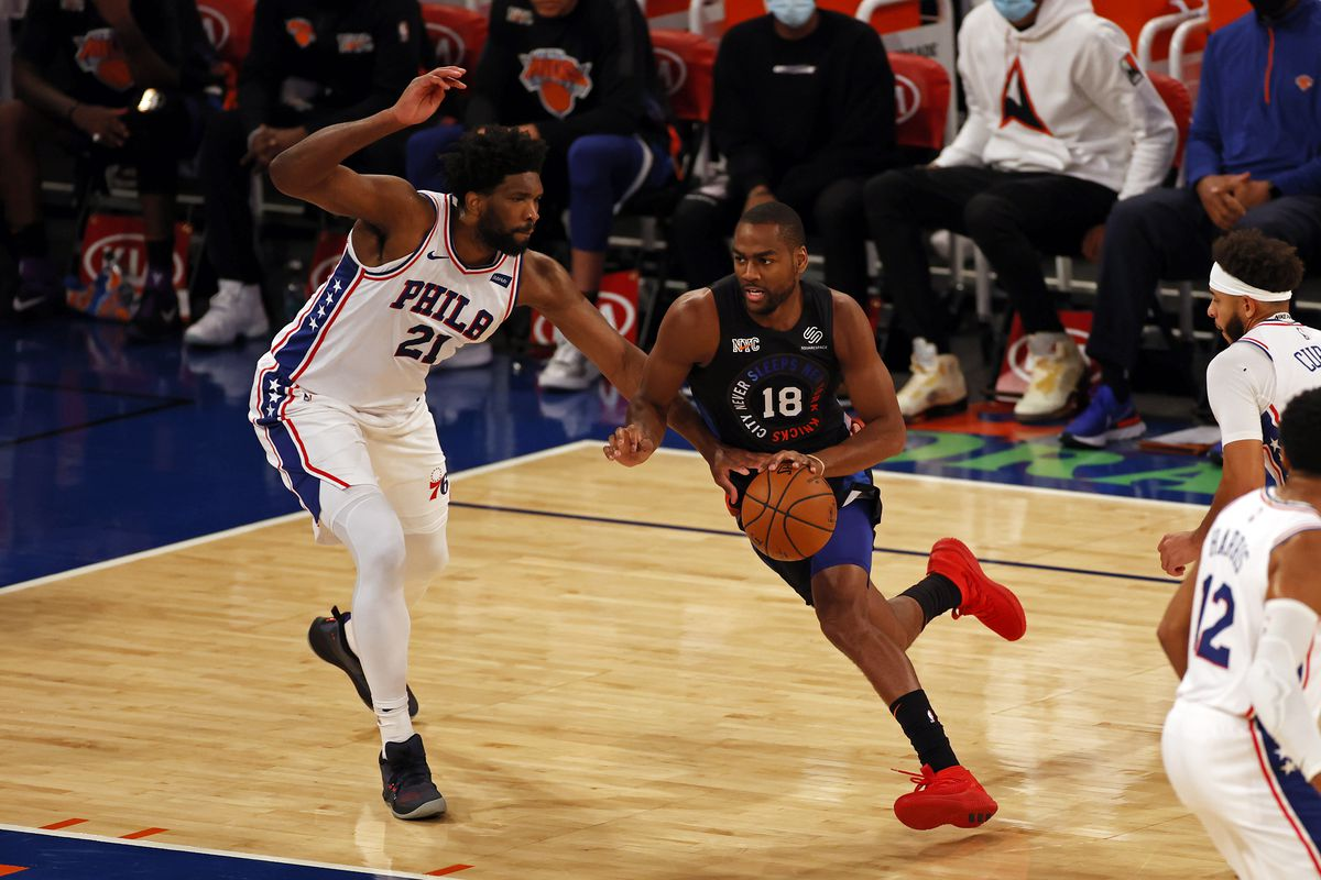 New York Knicks guard Alec Burks (18) drives to the basket past Philadelphia 76ers center Joel Embiid (21) during the first half of an NBA basketball game Saturday, Dec. 26, 2020, in New York. The 76ers defeated the Knicks 109-89 at Madison Square Garden.