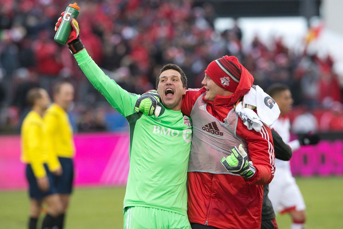 Julio Cesar celebrates a win in the 2013 home opener over eventual Eastern Champions, DC United, with his pupil, Joe Bendik
