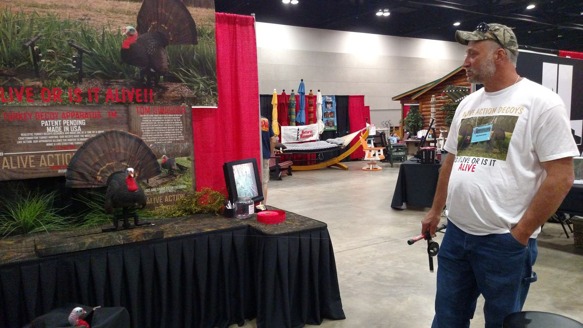 """Wade Gotter explains """"Tom Swagger"""" decoy at the Illinois Deer &amp; Turkey Expo at the Peoria Civic Center.<br>Credit: Dale Bowman"""