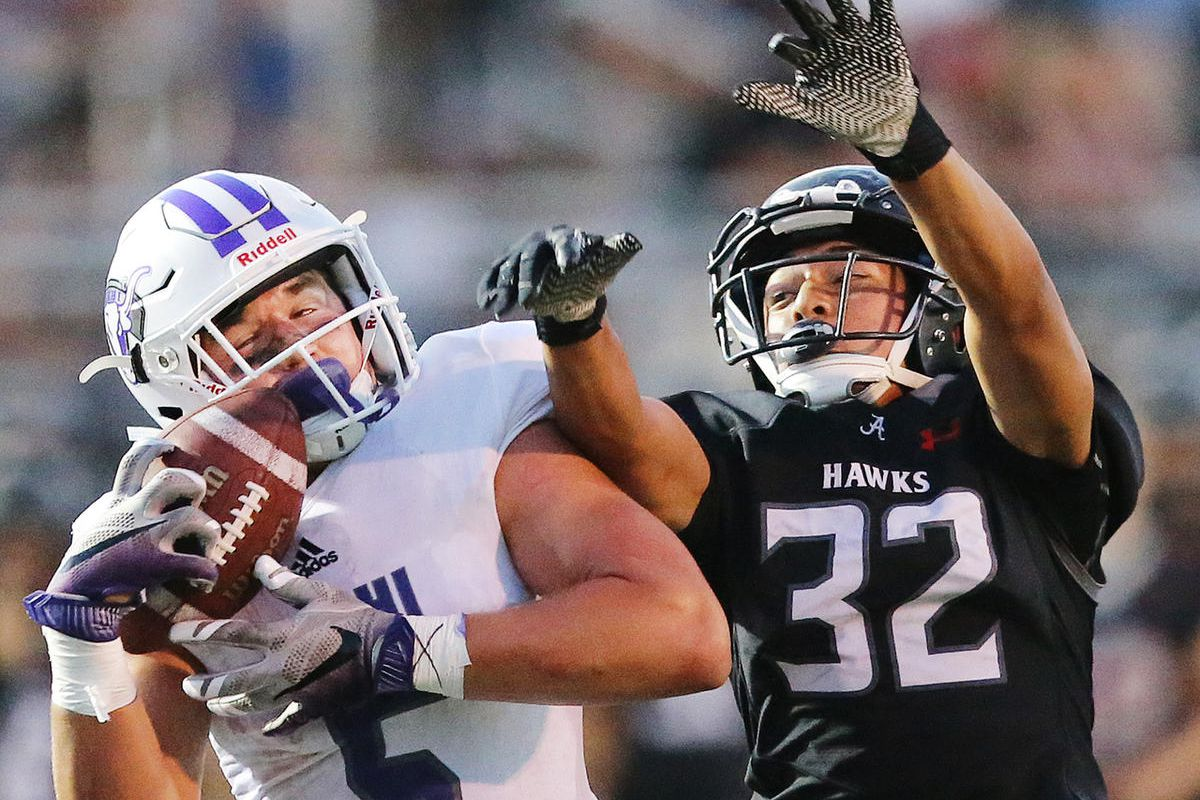 Lehi's Dallin Holker hauls in a 42 yard pass over the defense of Alta's Setefano Malieitulua as they battle in Utah High School football action at Alta on Friday, Aug. 18, 2017.