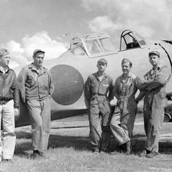 Clyde D. Gessel (on left in officer's uniform) with his American crew standing in front of the first reconstructed flyable Japanese Zero, assembled from five shot-up planes recovered in New Guinea.