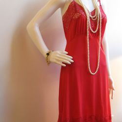 This sexy, coral pink slip is from the 1960s.  It has adjustable straps and a pleated detail at the hem.  Can be worn at night or if you feel creative you can make it into a daytime dress.  Size medium/large $17.50
