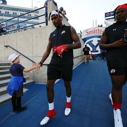 Utah Utes safety Tyrone Young-Smith gives Kyler Jones a hand slap as BYU and Utah prepare to play an NCAA football game at LaVell Edwards Stadium in Provo on Saturday, Sept. 11, 2021.