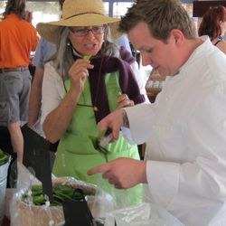 Kerry Clasby and chef Brian Howard from Comme Ça check out the snow peas.