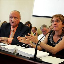 Sen. Chris Buttars, left, co-chairman of the Health and Human Services Interim Committee, and Judi Hilman, executive director of the Utah Helath Policy Project attend an interim committee meeting at the State Capitol Wednesday.