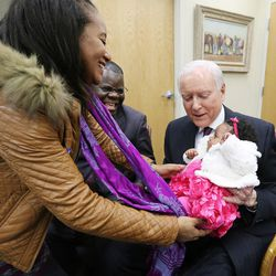 Sen. Orrin Hatch meets with Bosco Kayembe and his wife, Amina Ait Omar, and their baby, Aisha, in his office in Salt Lake City on Feb. 18, 2016. Hatch helped resolve a visa issue allowing Kayembe's wife to join him in the United States. Ait Omar was living in her native Morocco and experiencing complications with her pregnancy, when Hatch stepped in to help.