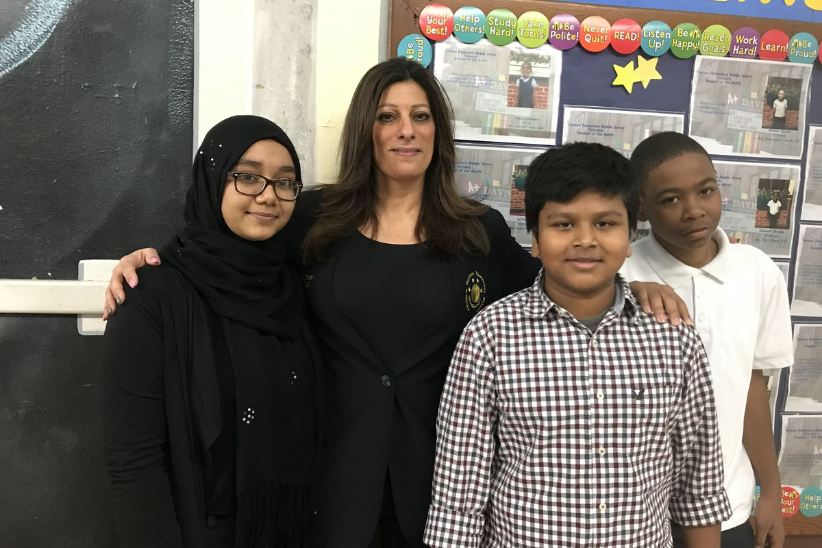 Teacher Michele Pizzo and students Wajiha Begum, Iftiker Choudhury and Demetrious Yancy are closer since she's visited their homes