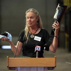 Cynthia Furse, professor of electrical and computer engineering at the University of Utah and associate vice president for research, holds a chunk of coal and a prosthetic leg that has been made out of carbon fiber at the U.'s Industrial Combustion and Gasification Facility in Salt Lake City on Wednesday, Oct. 26, 2016.