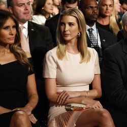 Melania Trump, left, Ivanka Trump, center, and vice presidential candidate Indiana Gov. Mike Pence wait for the beginning of the first presidential debate between Republican presidential candidate Donald Trump and Democratic presidential candidate Hillary Clinton at Hofstra University, Monday, Sept. 26, 2016, in Hempstead, N.Y.