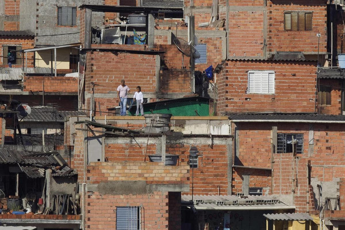 """The Paraisopolis slum is shown in Sao Paulo, Brazil, in this July 28, 2011, photo. Brazil has an anti-poverty program that is catching on in Latin America. Known as """"Family Grant,"""" it's a conditional cash-transfer program that gives families money for sen"""