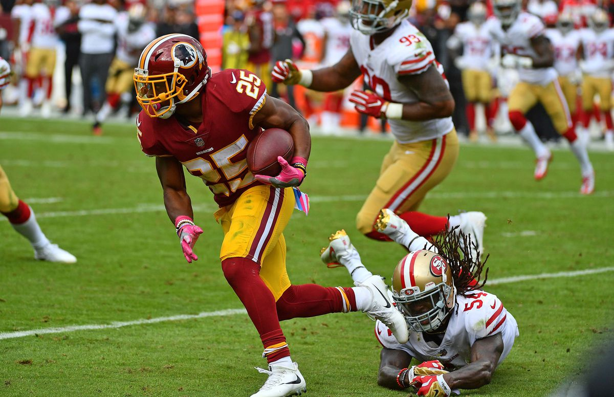 Oct 15, 2017; Landover, MD, USA; Washington Redskins running back Chris Thompson (25) avoids the tackle by San Francisco 49ers linebacker Ray-Ray Armstrong (54) during the first half at FedEx Field. Mandatory Credit: Brad Mills-USA TODAY Sports