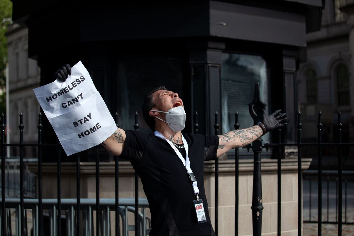 Homeless advocate Christopher Meier expresses himself during a protest at City Hall on May 27, 2020.