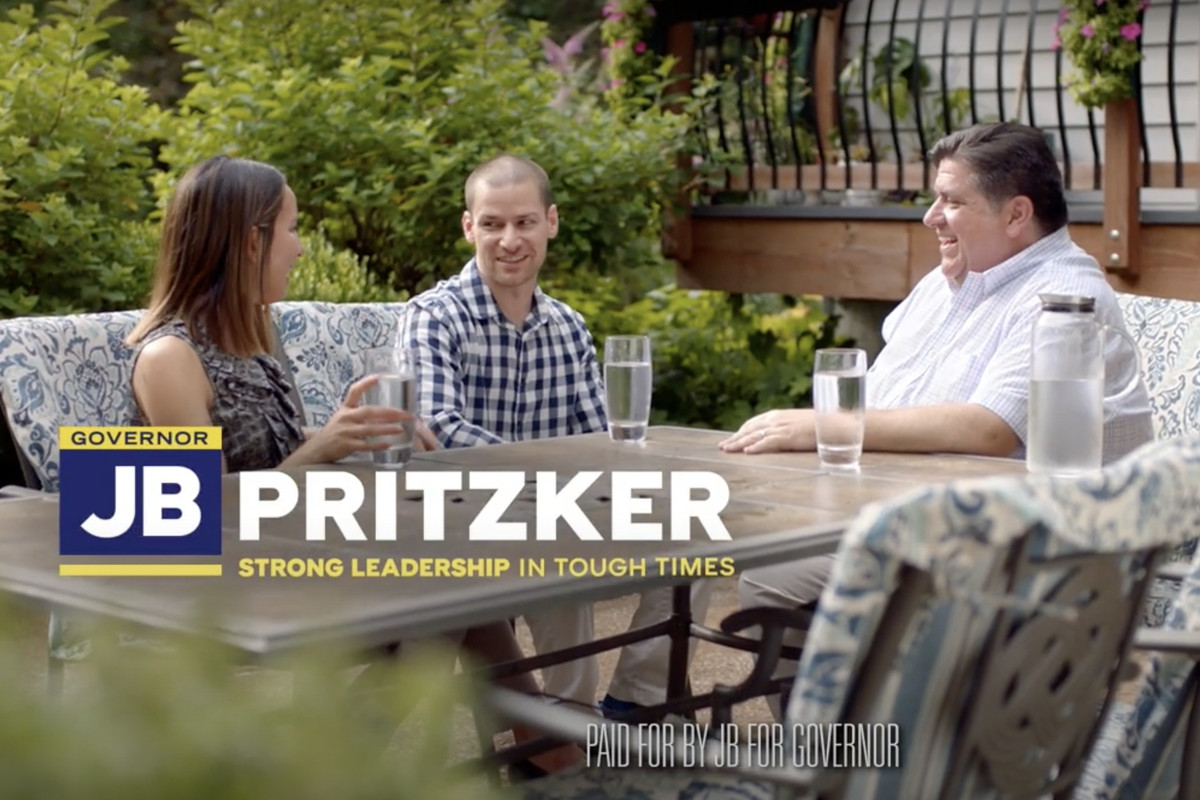 Gov. J.B. Pritzker, right, talks with Corey Brooks, center, in one of the three ads the governor's campaign released Friday.