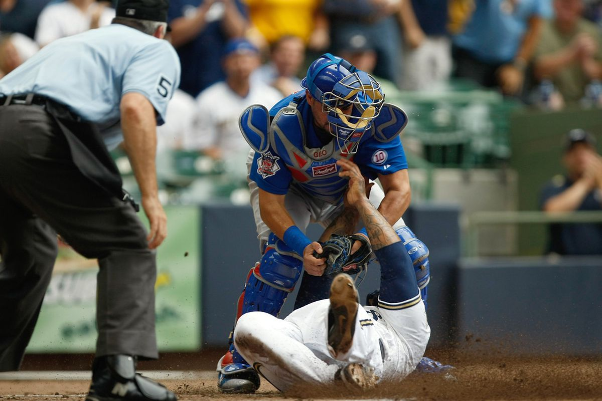 MILWAUKEE, WI - JULY 28: Geovany Soto #18 of the Chicago Cubs tags out Prince Fielder #28 of the Milwaukee Brewers as umpire Bill Welke looks on at Miller Park on July 28, 2011 in Milwaukee, Wisconsin. (Photo by Scott Boehm/Getty Images)