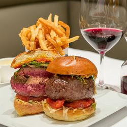 """<a href=""""http://ny.eater.com/archives/2014/08/map_new_york_city_burger_best_famous_minetta_pub.php"""">New York City's 13 Iconic Burgers</a>"""
