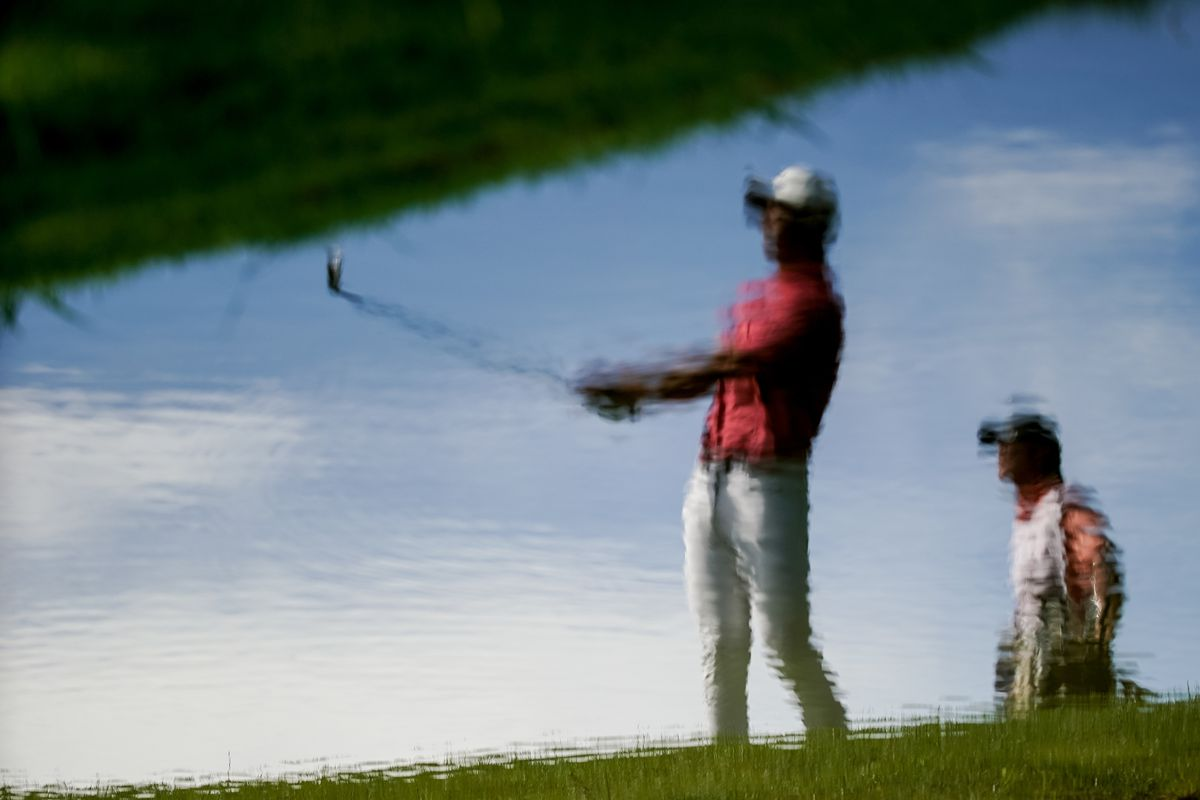 Reflected in a small pond, Ryan Ruffels hits from the rough during round three of the Korn Ferry Tour's Utah Championship at Oakridge Country Club in Farmington on Saturday, June 27, 2020. Ruffels ended the round tied for third.