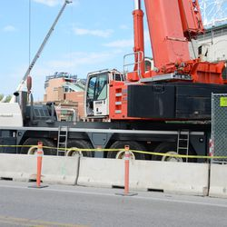 2:44 p.m. Part of the fencing on Clark Street removed to accommodate the counterweight on the back of this crane -