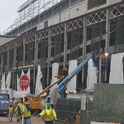 Wider view of west side (note workers in cherry-picker) -