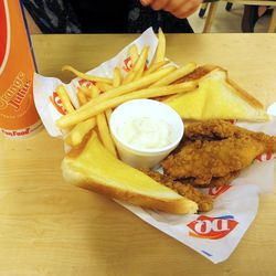Chicken fingers come with buttered toast and a rather flavorless ranch dressing.