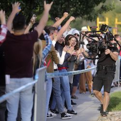 People cheer for the American Idol film crew while waiting in line for American Idol auditions outside of the Northwest Community Center in Salt Lake City on Thursday, Aug. 29, 2019.