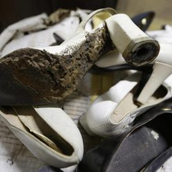 In this photo taken Sept. 19, 2012, a branded high heel shoe, once worn by flamboyant former Philippine first lady Imelda Marcos sits among equally-damaged shoes in a section of the National Museum in Manila, Philippine. Termites, storms and government neglect have damaged some of Imelda Marcos's legendary stash of shoes, expensive gowns and other vanity possessions, which were left to oblivion after she and her dictator husband were driven to U.S. exile by a 1986 popular revolt.
