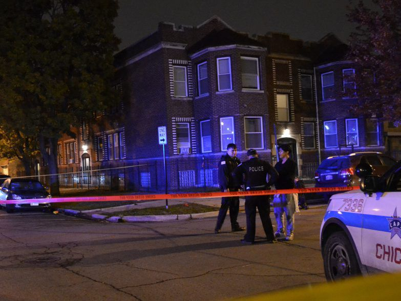 Police investigate a shooting about 4:30 a.m. Sunday, October 28, 2018 in the 6200 block of South Maplewood Avenue in Chicago. | Justin Jackson/ Sun-Times