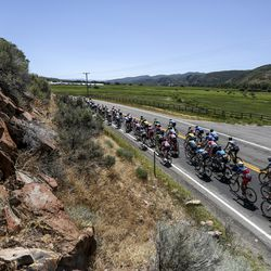 The peloton rides along state Route 32 during Stage 6 of the Tour of Utah near Peoa, Summit County, on Sunday, Aug. 18, 2019.
