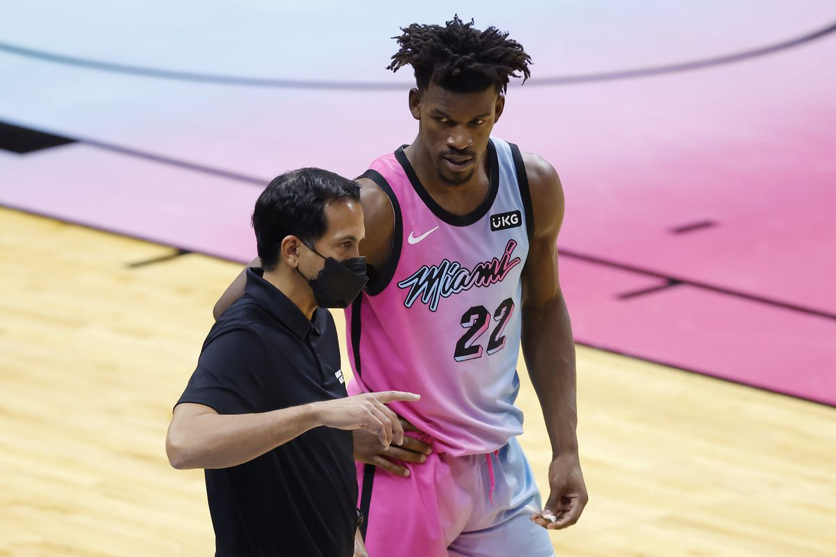 Head coach Erik Spoelstra of the Miami Heat talks with Jimmy Butler against the New York Knicks during the fourth quarter at American Airlines Arena on February 09, 2021 in Miami, Florida.