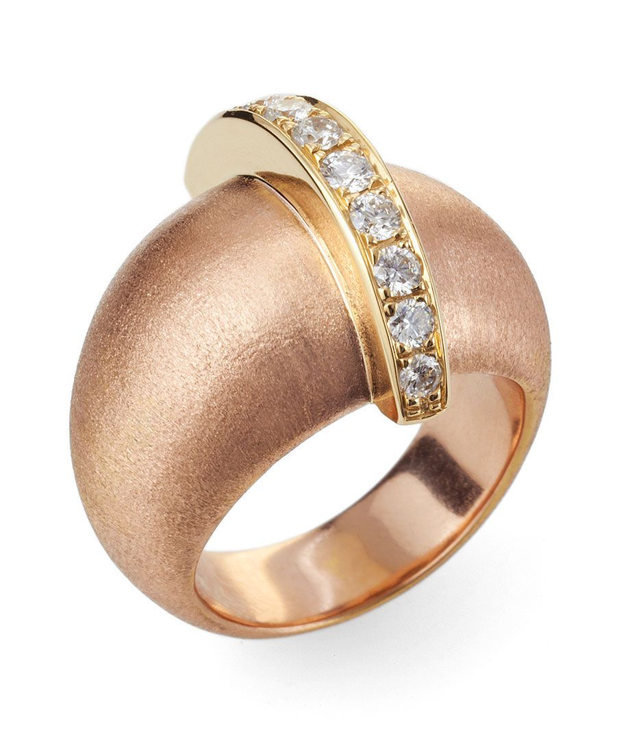 A close up of a gold and white diamond ring