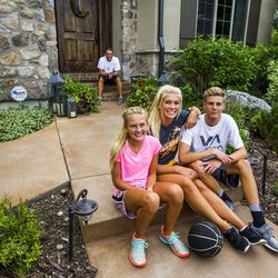 Kurt Christensen is pictured with his children Elle, 13, left, McCall, 18, and Adam, 15, at their home in Cottonwood Heights on Wednesday, Aug. 12, 2015.