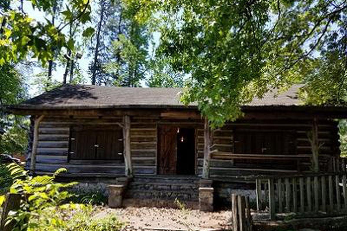 North of atlanta depression era log cabin slated for move for Elevated log cabin
