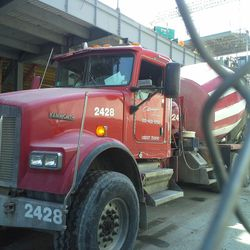 2:12 p.m. Concrete truck on Waveland, using the bucket transfer system -