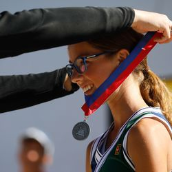 Green Canyon sophomore Emma Murri smiles as she receives a medal for winning the third singles final during the 4A girls singles tennis state tournament at Liberty Park Tennis Center in Salt Lake City on Saturday, Oct. 2, 2021.