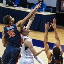 Brigham Young Cougars forward Matt Haarms (3) shoots the ball over Pepperdine Waves forward Kessler Edwards (15) at the Marriott Center in Provo on Saturday, Jan. 23, 2021.