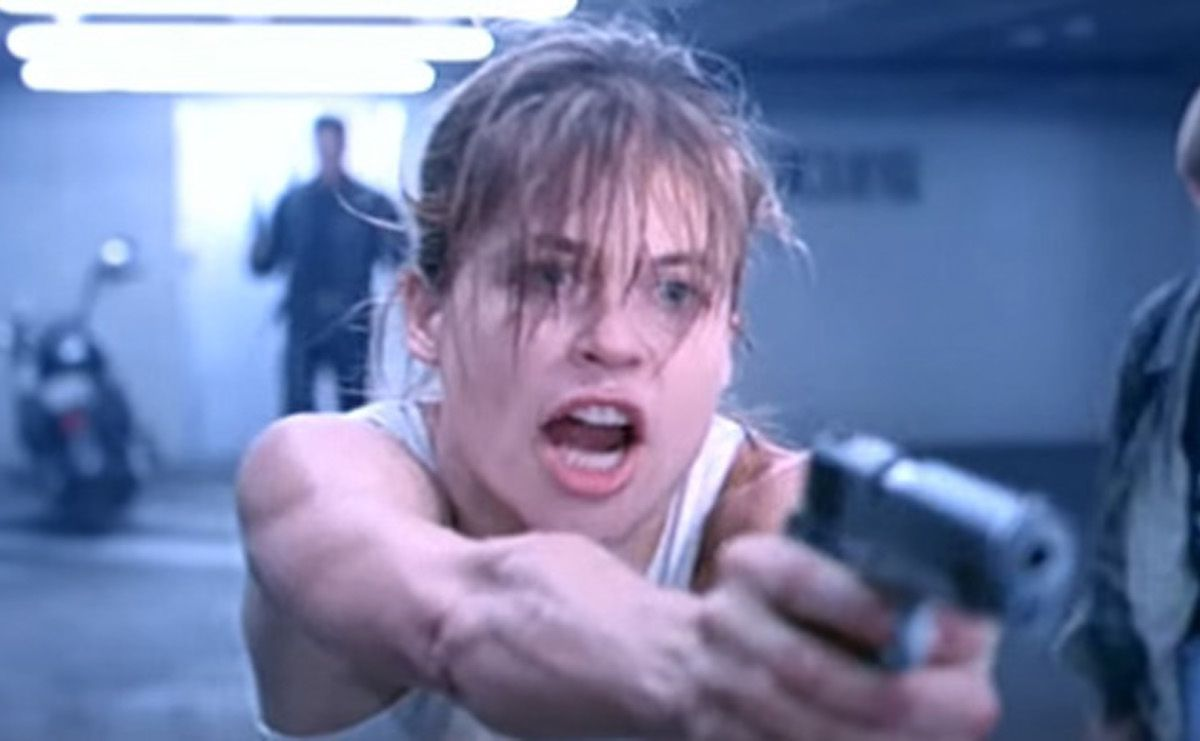 """Sarah Connor points a gun at a police officer in the parking garage of Pescadero Hospital in """"Terminator 2."""""""