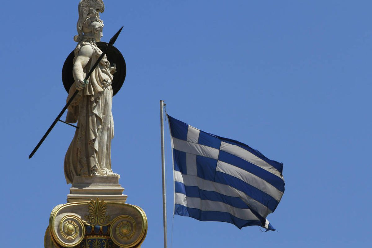 A Greek flag waves by the statue of the goddess Athina, in Athens, Friday, June 22, 2012. In Greek mythology, King Sisyphus pushed a boulder up a hill, over and over, forever, in a futile exercise that a few commentators have compared to international eff