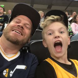 Jazz fans Jeremy Howlett, left, and Talmage Howlett pose for a selfie at Vivint Arena back in the good-old days when sports events actually took place before the coronavirus-caused stoppage.