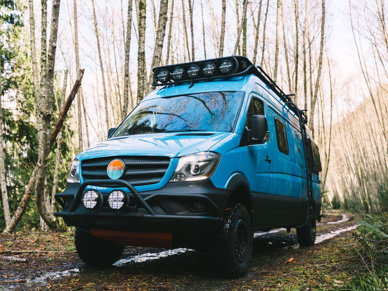 """The <a href=""""http://nomadvanz.com/gallery/beautiful-custom-vanz/out-of-the-blue/"""" target=""""_blank"""">Out of the Blue</a> camper van by <a href=""""http://nomadvanz.com/"""" target=""""_blank"""">Nomad Vanz</a>."""
