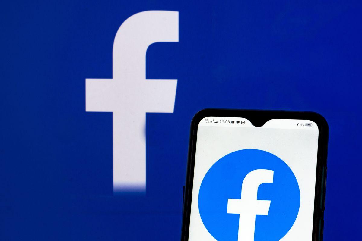 In this photo illustration Facebook, Inc. logo seen...