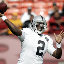 Oakland Raiders quarterback JaMarcus Russell throws the ball.