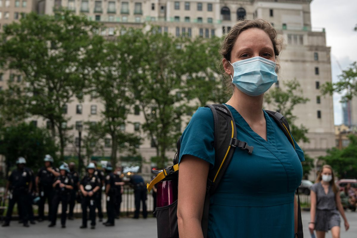 """""""What we are doing here socially is worth it,"""" said speech language pathologist, Elizabeth, about mass protests during the coronavirus outbreak, June 5, 2020. """"Hopefully the pandemic keeps going down as this movement gains traction."""""""