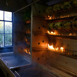 Do not envy the cooks stationed in front of this beast in the tight kitchen. (Note the whole cabbages roasting away, though.)